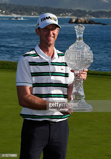 Vaughn Taylor poses with the trophy after winning the ATT Pebble Beach National ProAm at the Pebble Beach Golf Links on February 14 2016 in Pebble...