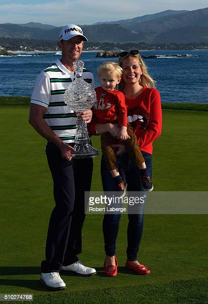Vaughn Taylor poses with the trophy, along with wife Leot and son Locklyn, after winning the AT&T Pebble Beach National Pro-Am at the Pebble Beach...