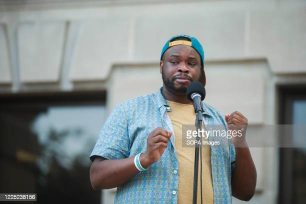 Vauhxx Booker, blue shirt, speaks during a community gathering to fight against racism. Protesters are demanding justice for Vauhxx Booker, who was...