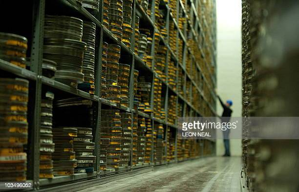 Vault Assistant Darren Slattery works in the acetate vault at the BFI film archive in Berkhamsted Hertfordshire on July 23 2010 Examining buckled...