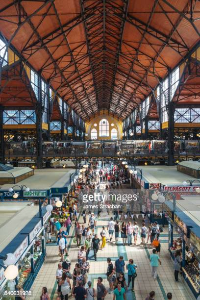Vaulted interior of Central Market with crowds of shoppers below, Budapest, Hungary