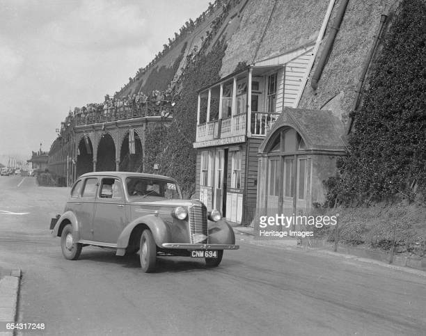 Vauxhall 146 of GL Boughton competing in the RAC Rally Madeira Drive Brighton 1939 Artist Bill Brunell Vauxhall FourteenSix 1781 cc Reg No CNM694...