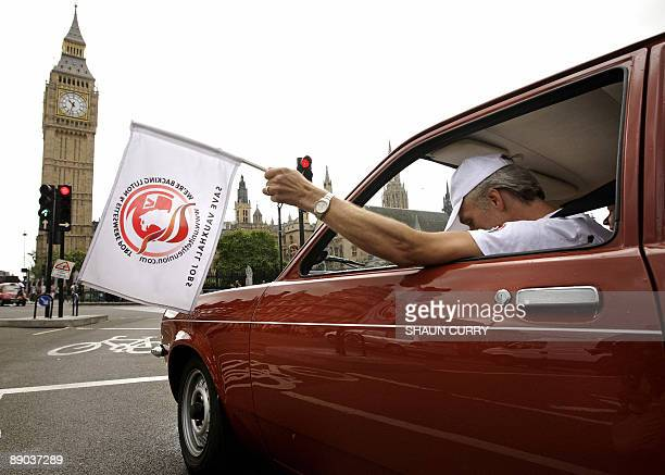 Vauxhall car workers drive a convoy of the company's models around the Houses of Parliament in London on July 15 as they attempt to highlight the...