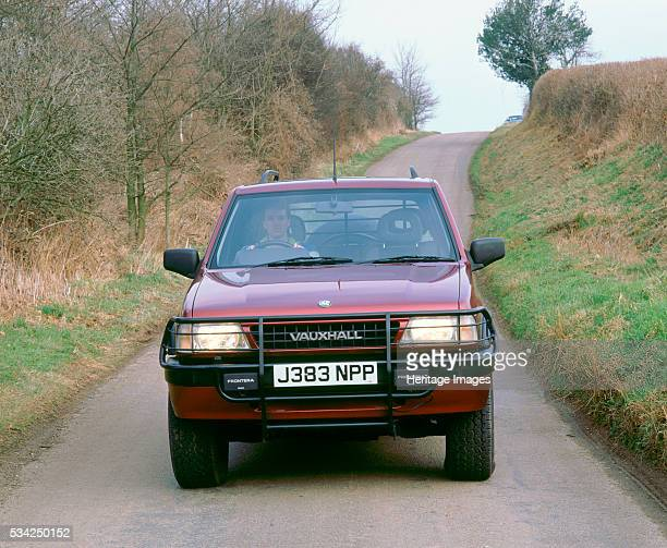 Vauxhall Frontera driving on country lane 2000