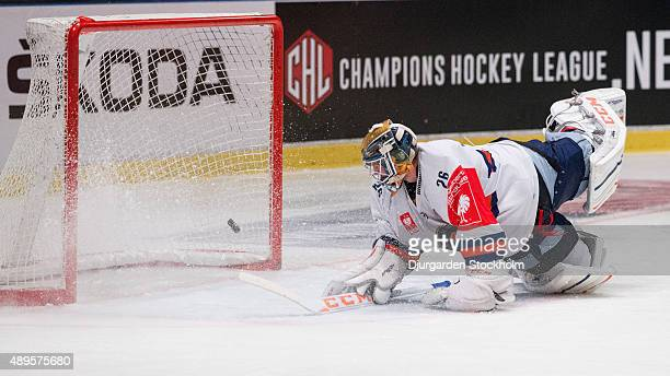 Vaxjo goalkeeper Stefan Steen sees watches the puck in the net as Fredrik Forsberg and Djurgarden score during the Champions Hockey League round of...