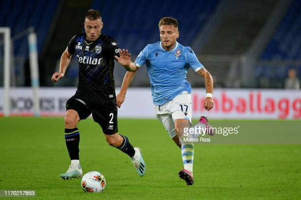 VCiro Immobile of SS Lazio compete for the ball with Simone Iacoponi of Parma Calcio during the Serie A match between SS Lazio and Parma Calcio at...