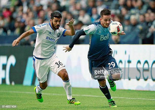 Víctor Cabrera of the Montreal Impact and Octavio Rivero of the Vancouver Whitecaps chase a loose ball during their MLS game March 6 2016 at BC Place...