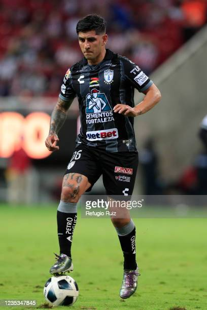Víctor Guzmán of Pachuca drives the ball during the 9th round match between Chivas and Pachuca as part of the Torneo Grita Mexico A21 Liga MX at...
