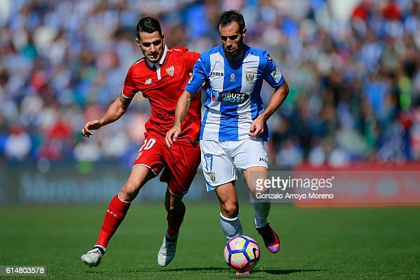 Vctor Machin alias Vitolo of Sevilla FC competes for the ball with Victor Diaz of Deportivo Leganes during the La Liga match between CD Leganes and...