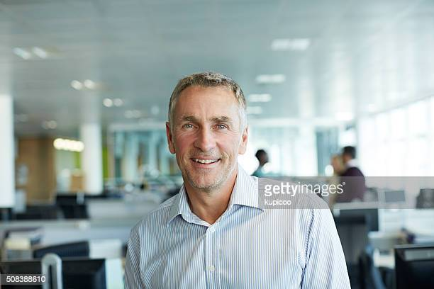 i've achieved a lot in my team - man in office stock photos and pictures