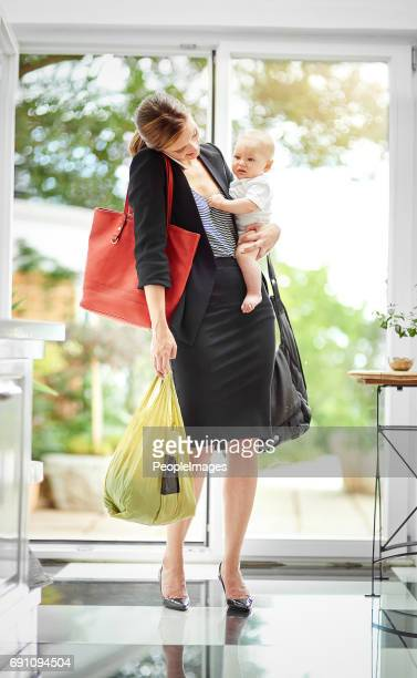 i've my hands full at the moment, talk later - super mom stock photos and pictures