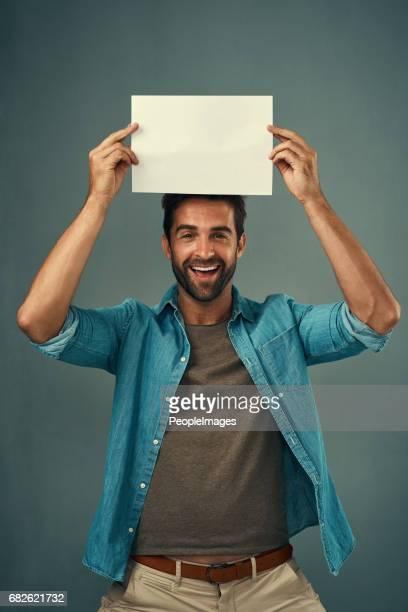 i've saved this space just for you - man holding paper imagens e fotografias de stock