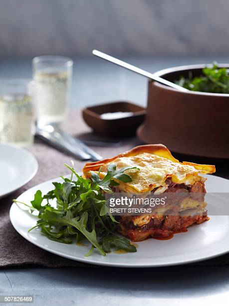 veal and pork lasagne with rocket - lasagna stock pictures, royalty-free photos & images