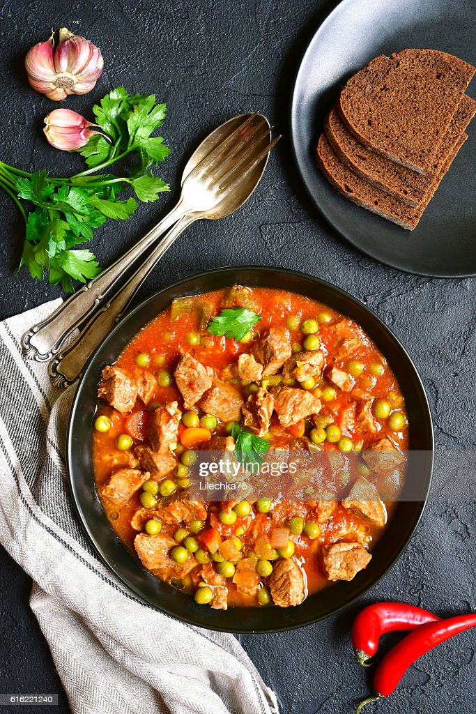 Veal stewed with vegetables in tomato sauce.Top view. : Stockfoto