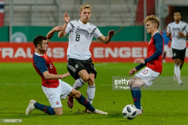 Vebjoern Hoff of Norway Arne Maier of Germany and Martin Odegaard of Norway battle for the ball during the 2019 UEFA Under21 European Championship...