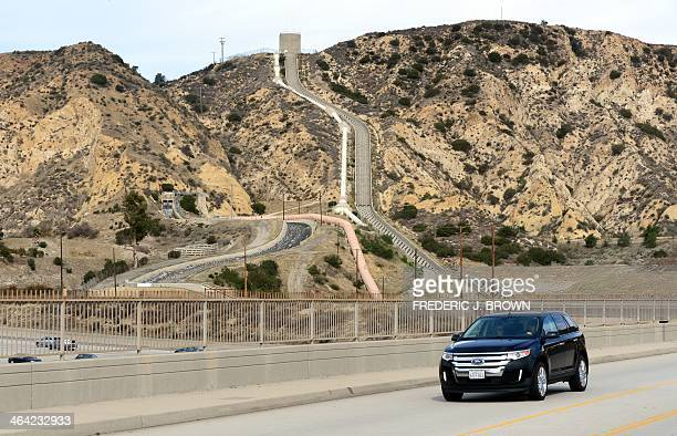 A vechicle crosses an overpass near the Los Angeles Aqueduct nestled amid a dry and barren hillside in Sylmar California north of Los Angeles on...