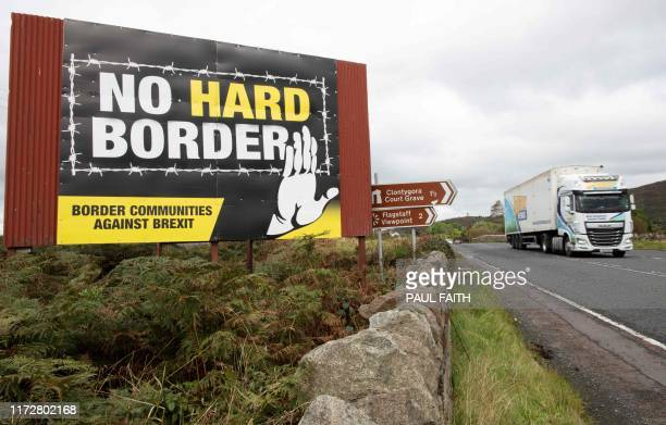 TOPSHOT A vechile passes an antiBrexit proIrish unity billboard seen from the Dublin road in Newry Northern Ireland on October 1 2019 on the border...