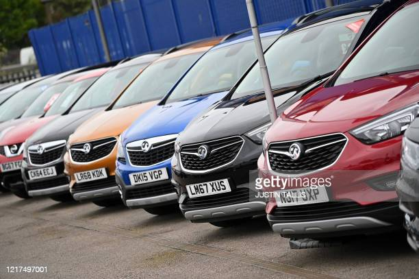 Vechiles are parked on the forecourt of a recently re-opened Vauxhall car dealership in north London on June 4 as lockdown restrictions are eased...