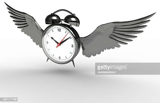 vector alarm clock with wings over a white background - time travel stock pictures, royalty-free photos & images
