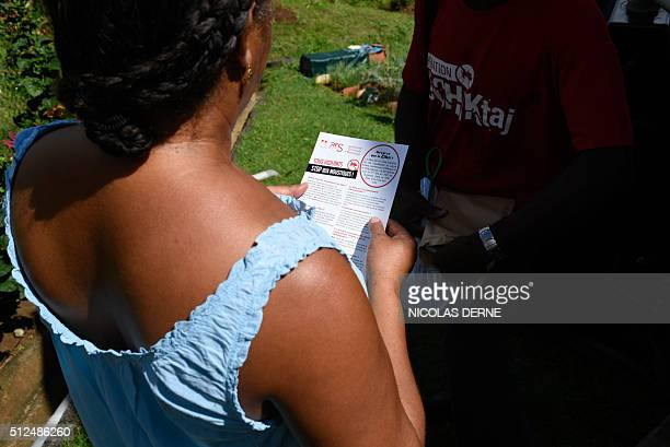 A vector control agent distributes flyers in the Riviere Pilote district in Martinique French overseas territories on February 20 to fight against...