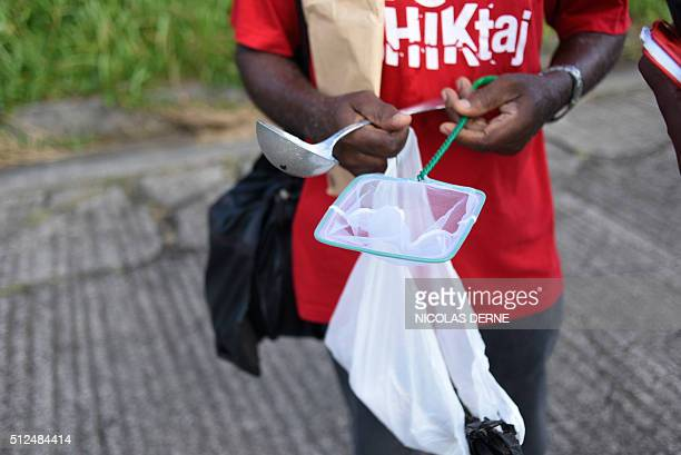 A vector control agent shows entomologist material as he patrols in the Riviere Pilote district in Martinique French overseas territories on February...