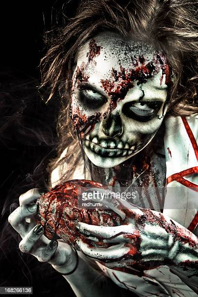 vector illustration of zombie nurse eating heart - zombie makeup stock photos and pictures