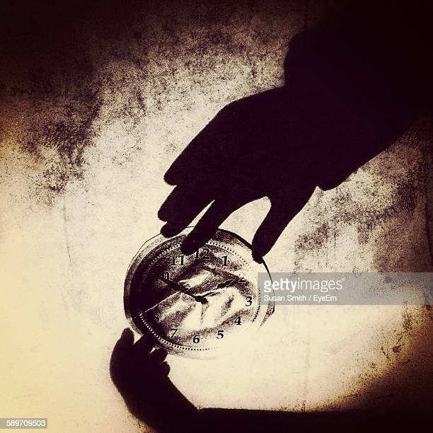 Vector Image Of Hands Holding Clock