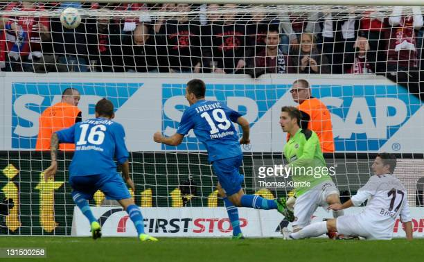 Vedad Ibisevic, 2nd L, of Hoffenheim scores the opening goal past goalkeeper Kevin Trapp and Alexander Bugera, R, of Kaiserslautern during the...