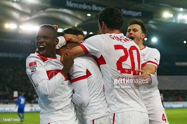 Vedad Ibisevic 8hidden) of Stuttgart celebrates his team's second goal with team mates during the Bundesliga match between VfB Stuttgart and...