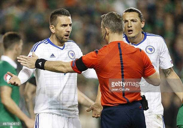 Vedad Ibisevic and Milan Djuric of Bosnia and Herzegovina argue with referee Bjorn Kuipers of Netherlands during the UEFA EURO 2016 qualifier playoff...