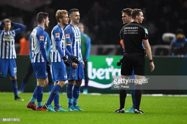 Vedad Ibisevic Fabian Lustenberger Mathew Leckie and Sebastian Langkamp of Hertha BSC argue with referee Soeren Storks during the game between Hertha...