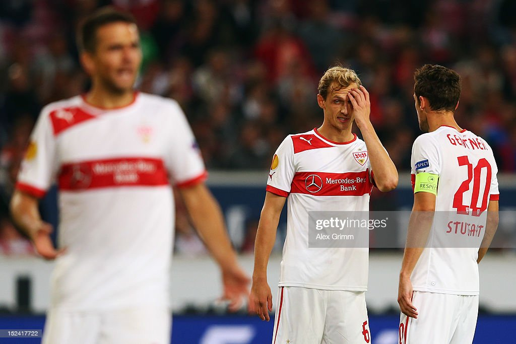 Vedad Ibisevic, Georg Niedermeier and Christian Gentner (L-R) of Stuttgart react during the UEFA Europa League group E match between VfB Stuttgart and FC Steaua Bucuresti at Mercedes-Benz-Arena on September 20, 2012 in Stuttgart, Germany.