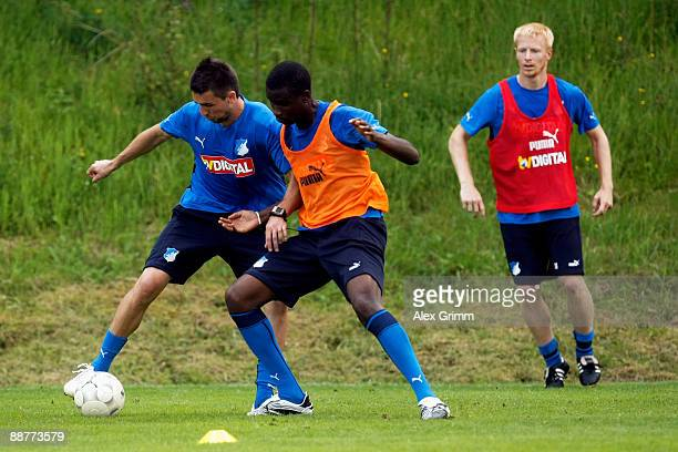 Vedad Ibisevic is challenged by Albert Alex and Andreas Ibertsberger during a training session of 1899 Hoffenheim during a training camp on July 1,...