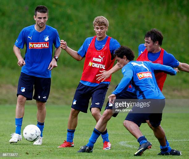 Vedad Ibisevic is challenged by Boris Vukcevic, Carlos Eduardo and Christian Eichner during a training session of 1899 Hoffenheim during a training...