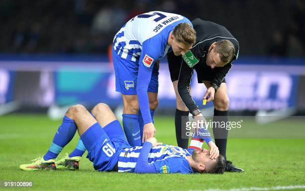 Vedad Ibisevic Niklas Stark of Hertha BSC and referee Martin Petersen during the first Bundesliga game between Hertha BSC and 1st FSV Mainz 05 at...