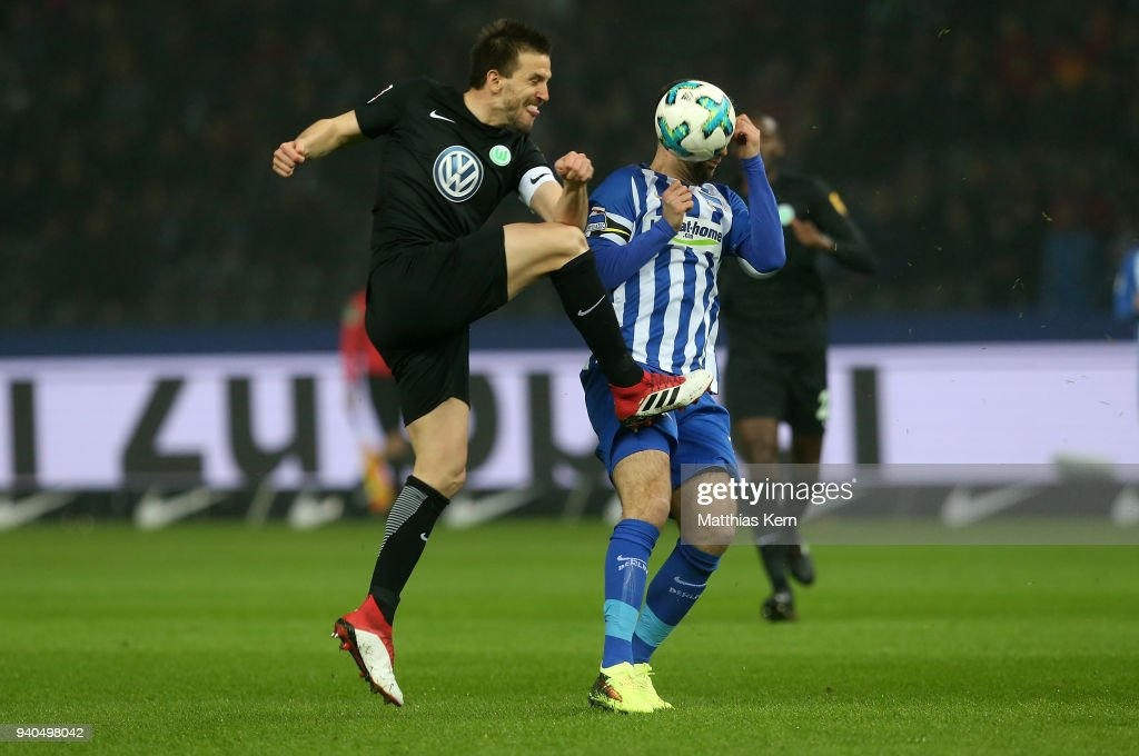 Vedad Ibisevic (R) of Berlin battles for the ball with Ignacio Camacho of Wolfsburg during the Bundesliga match between Hertha BSC and VFL Wolfsburg at Olympiastadion on March 31, 2018 in Berlin, Germany.