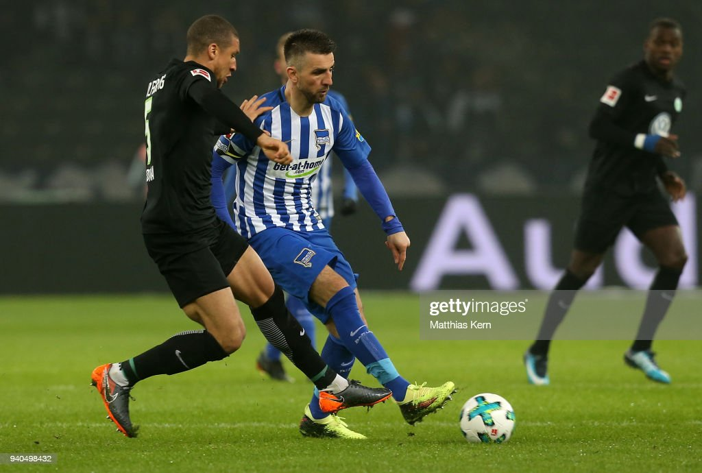 Vedad Ibisevic (R) of Berlin battles for the ball with Jeffrey Bruma of Wolfsburg during the Bundesliga match between Hertha BSC and VFL Wolfsburg at Olympiastadion on March 31, 2018 in Berlin, Germany.