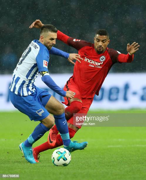 Vedad Ibisevic of Berlin battles for the ball with Kevin Prince Boateng of Frankfurt during the Bundesliga match between Hertha BSC and Eintracht...