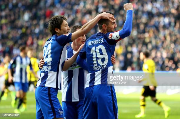 Vedad Ibisevic of Berlin celebrates after Salomon Kalou of Berlin scored his teams first goal during the Bundesliga match between Hertha BSC and...