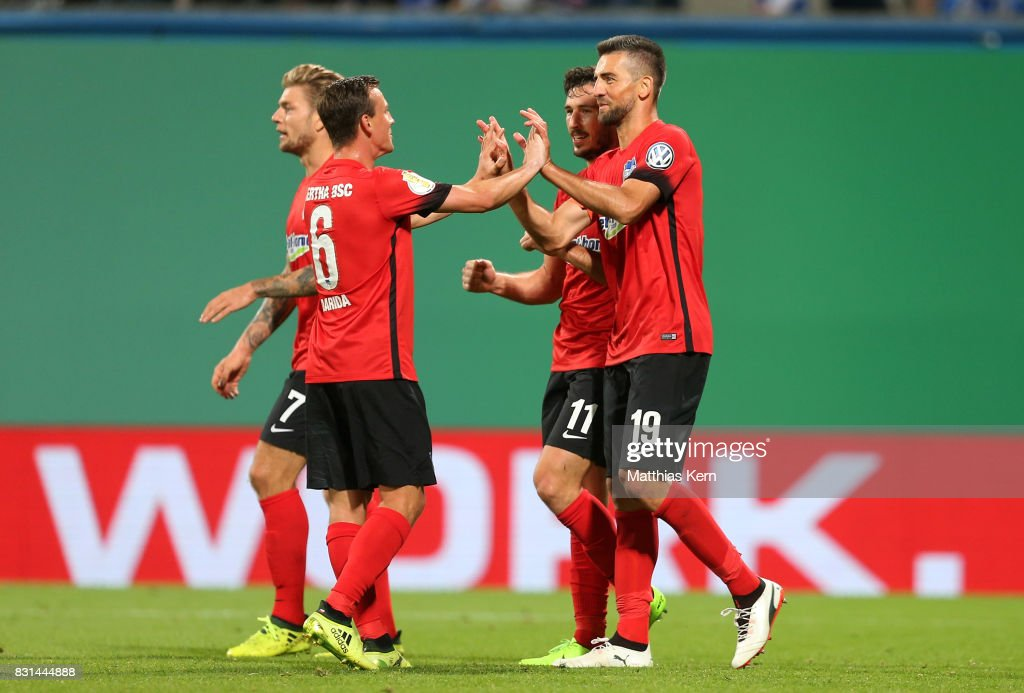 Vedad Ibisevic (R) of Berlin celebrates with team mates after scoring the second goal during the DFB Cup first round match between FC Hansa Rostock and Hertha BSC at Ostseestadion on August 14, 2017 in Rostock, Germany.