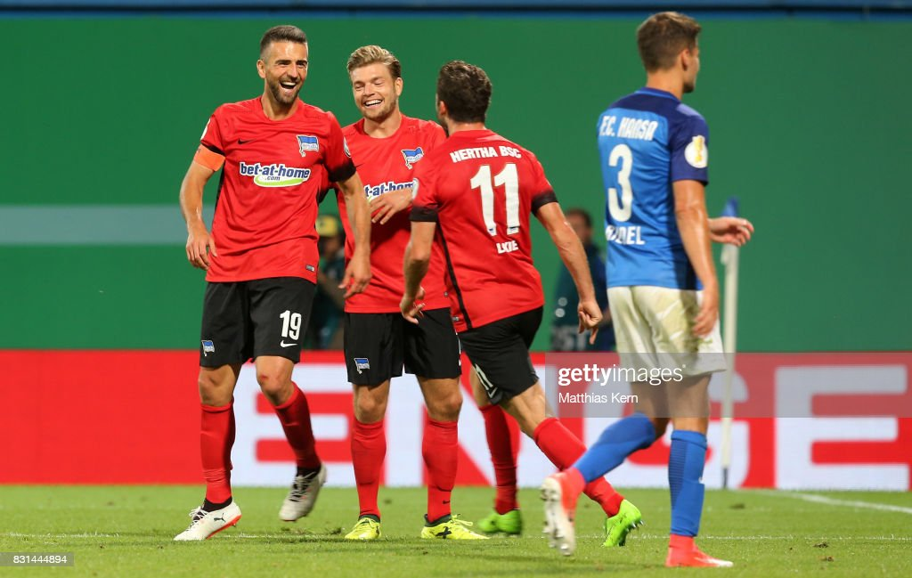 Vedad Ibisevic (L) of Berlin celebrates with team mates after scoring the second goal during the DFB Cup first round match between FC Hansa Rostock and Hertha BSC at Ostseestadion on August 14, 2017 in Rostock, Germany.