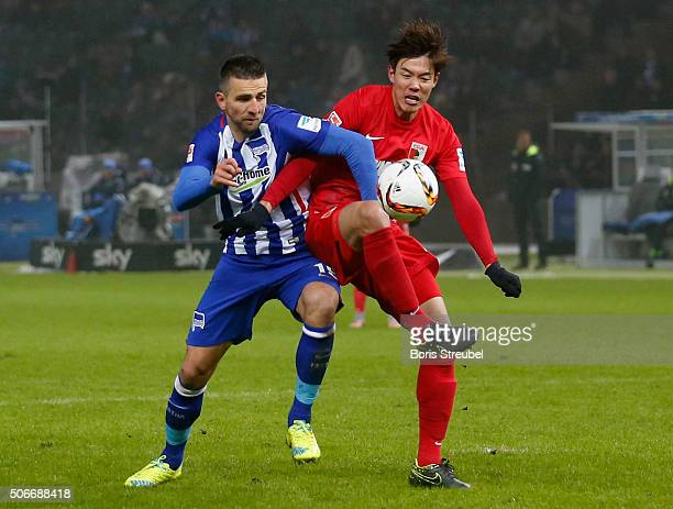 Vedad Ibisevic of Berlin fights for the ball with JeongHo Hong of Augsburg during the Bundesliga match between Hertha BSC and FC Augsburg at...