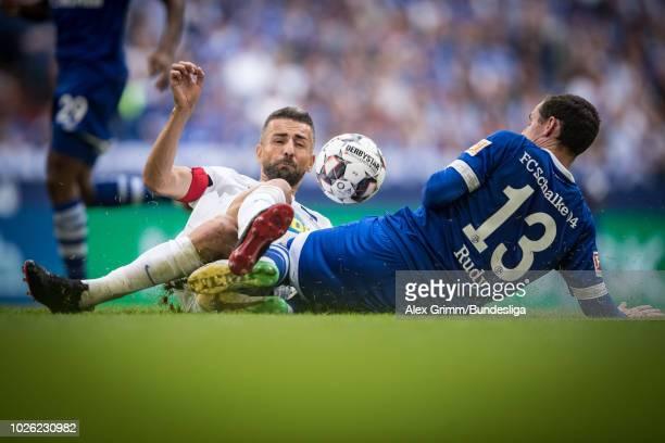 Vedad Ibisevic of Berlin is challenged by Sebastian Rudy of Schalke during the Bundesliga match between FC Schalke 04 and Hertha BSC at VeltinsArena...