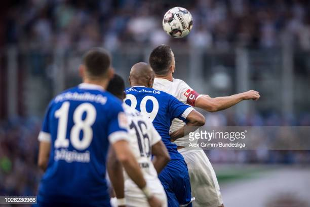 Vedad Ibisevic of Berlin jumps for a header with Naldo of Schalke during the Bundesliga match between FC Schalke 04 and Hertha BSC at VeltinsArena on...
