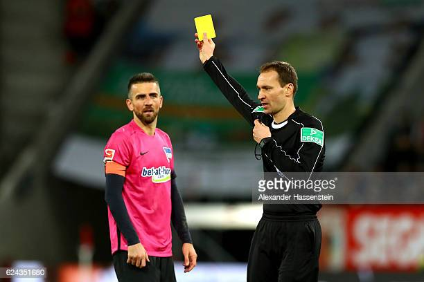 Vedad Ibisevic of Berlin receives the yellow card from referee Bastian Dankert during the Bundesliga match between FC Augsburg and Hertha BSC at WWK...