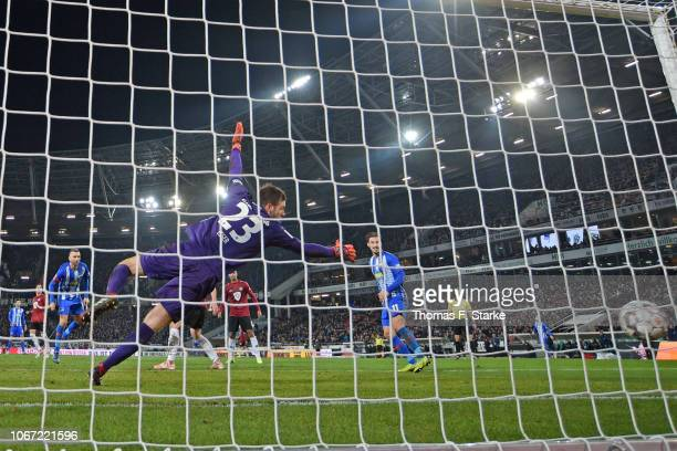 Vedad Ibisevic of Berlin scores against goalkeeper Michael Esser of Hannover during the Bundesliga match between Hannover 96 and Hertha BSC at...