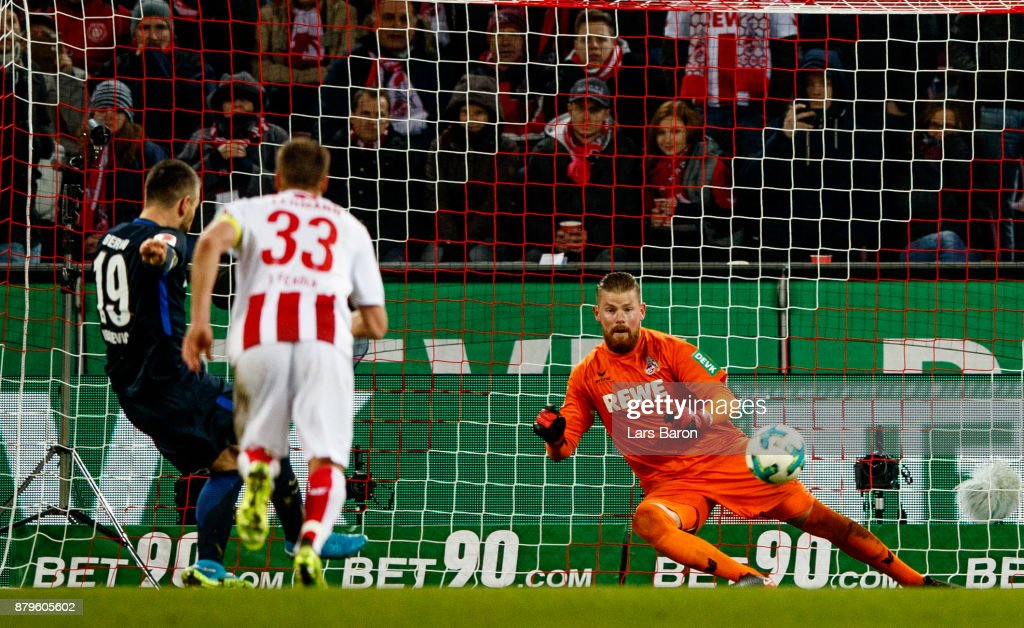 Vedad Ibisevic of Berlin scores his teams second goal against Timo Horn of Koeln during the Bundesliga match between 1. FC Koeln and Hertha BSC at RheinEnergieStadion on November 26, 2017 in Cologne, Germany.