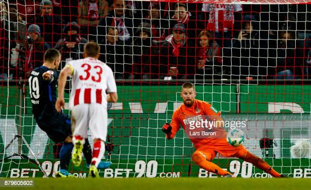 Vedad Ibisevic of Berlin scores his teams second goal against Timo Horn of Koeln during the Bundesliga match between 1. FC Koeln and Hertha BSC at...