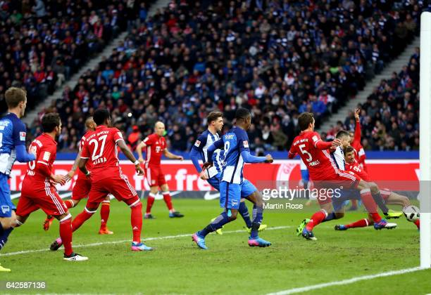 Vedad Ibisevic of Berlin scores the opening goal during the Bundesliga match between Hertha BSC and Bayern Muenchen at Olympiastadion on February 18...