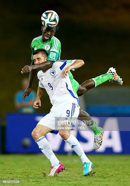 Vedad Ibisevic of Bosnia and Herzegovina and Kenneth Omeruo of Nigeria compete for the ball during the 2014 FIFA World Cup Brazil Group F match...